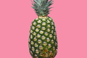 Fresh pineapple on the pink colorfurful background