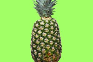 Pineapple on a light green background. Minimal style.