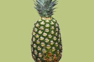 Fresh pineapple on the light brown colorfurful background
