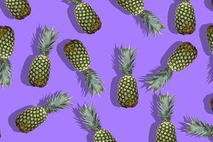 Fresh pineapples on the violet colorfurful background