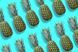 Fresh pineapples on the blue colorfurful background