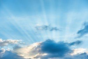 Sun rays shining through clouds