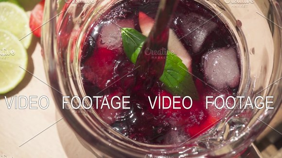 Slow Motion In A Carafe With Ice And Fruit To Pour Wine