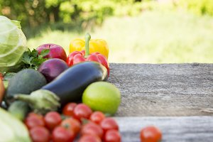 Raw vegetables and fruits on wooden