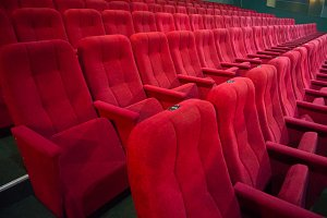 Aisle with rows of red seats