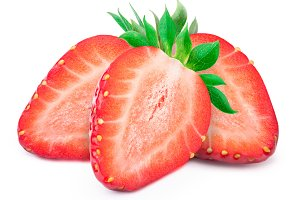 Three sliced strawberries with leafs isolated