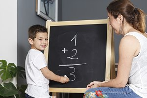 Mother teaches her son math at home