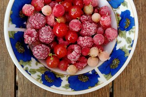 Red berries fruits on a dish