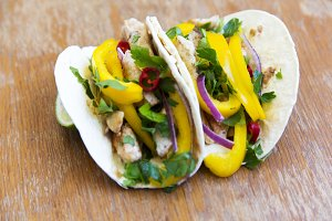 Tasty tacos with grilled chicken