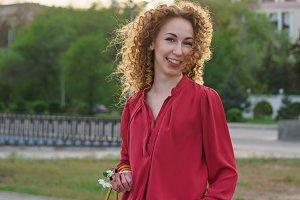 Girl with curly hair. Springtime