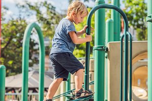 Funny cute happy baby playing on the playground. The emotion of happiness, fun, joy