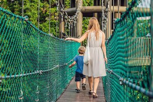 Mother and son at the Suspension bridge in Kuala Lumpur, Malaysia