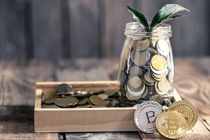 coin Bitcoin and a jar with coins