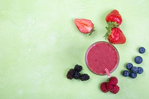 Creative layout of fresh berry smoothie