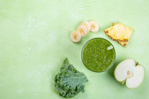 Creative layout of fresh green smoothie