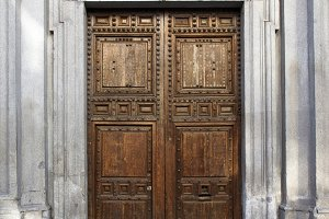 Old door in majestic building entran