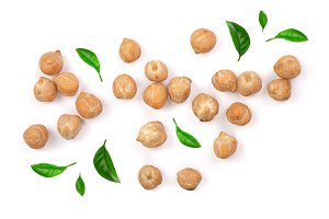 Dry raw organic chickpeas decorated with green leaves isolated on white background. Top view