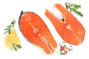 Slice of red fish salmon with lemon, rosemary and peppercorns isolated on white background. Top view. Flat lay