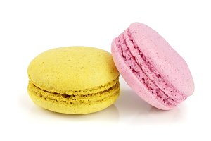 pink and yellow macaroon isolated on white background closeup