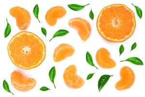 slices of tangerine with leaves isolated on white background. Flat lay, top view.