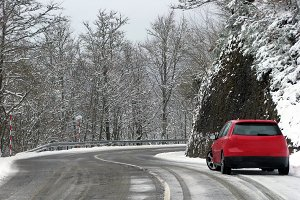 Red Car on snowy road