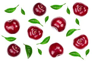 Sweet red cherries decorated with leaves isolated on white background with copy space for your text. Top view. Flat lay