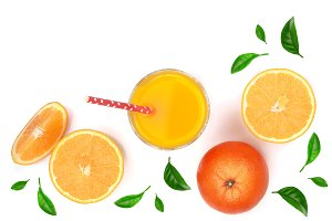 orange juice glass with slices of citrus and green leaves isolated on white background, top view. Flat lay pattern