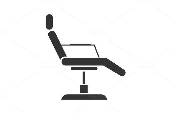 Tattoo chair glyph icon
