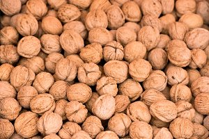 Whole walnuts background texture