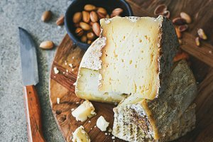 Cheese platter with cheese assortment, nuts, honey and bread