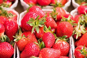 Natural strawberries in boxes at a