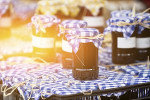 Many preserving jars with dark jam
