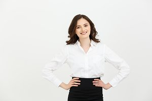 Business Concept: Portrait of Beautiful young business woman posing over white background.