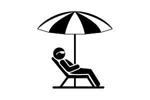 A man in a deckchair and umbrella.