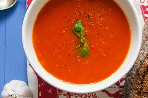 Tomato soup garnished with basil leaves