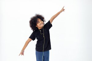 African American afro kid listening the music  with earphones - in white isolated background
