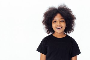 Cute and happy African American kid smiling and laughing isolated over white background