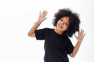 Pre-teen African American kid putting hands up being playful and happy isolated over white background