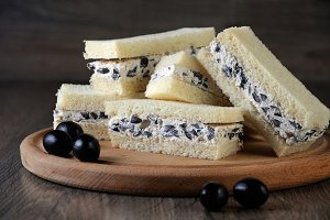 Sandwiches with ricotta and olives