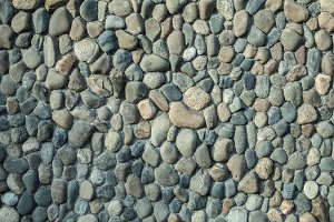 Sea pebble sea stones background natural polished