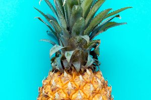 Pineapple on turquoise background