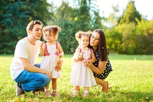 Happy family in the park outdoors in summer, autumn. Mother, fat