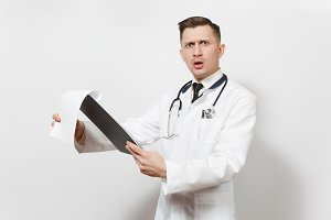 Shocked experienced handsome young doctor man isolated on white background. Male doctor in medical uniform, stethoscope health card on notepad folder. Healthcare personnel, health, medicine concept.