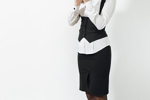 Full length portrait of beautiful European young smiling brown-hair business woman in black suit, white shirt clapping isolated on white background. Manager or worker. Copy space for advertisement.