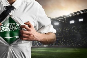 Saudi Arabia soccer or football supporter showing flag