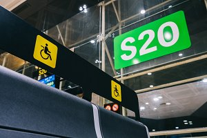 Empty Priority seats, chairs in the departure hall gate at international airport reserved for disability