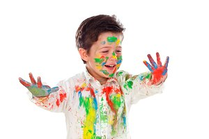 Happy child full of paint