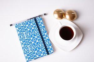 Closed agenda with coffee.