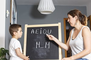 Little kid learnig the letters