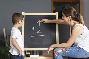Mother teaches her son math